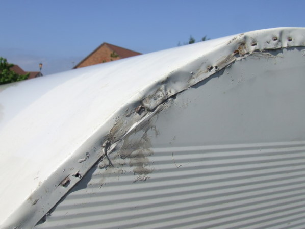 The Photo Below Shows Another Cut Short Area Where Side Sheet Is Completely Missed By Screws Through Awning Rail It Meets With GRP